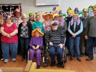 Members of Falls Active Adult center enjoy Mardi Gras party