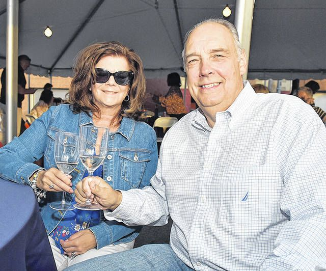 <p>Ed and Monica Perry toast the evening during the Greater Pittston Chamber of Commerce and Women's Network's Dancing in the Street fundraiser held outdoors at the chamber parking lot on Sept. 25.</p>                                  <p>Tony Callaio | For Sunday Dispatch</p>