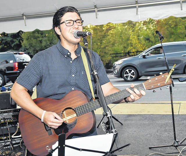 <p>Joe Burke, shown, along with The Sperazza Band, performed during the Greater Pittston Chamber's Dancing in the Street fundraiser.</p>                                  <p>Tony Callaio | For Sunday Dispatch</p>