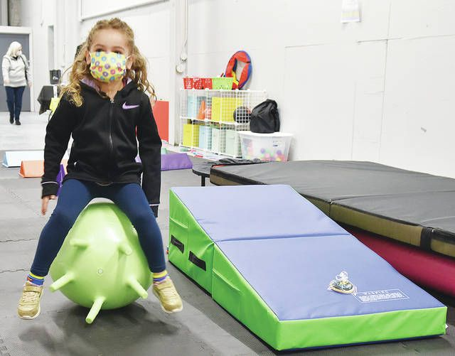 <p>Two-year-old Luciana Zangardi tries out some of the gym equipment for children at The Anthracite Fitness Factory.</p>                                  <p>Tony Callaio | For Sunday Dispatch</p>