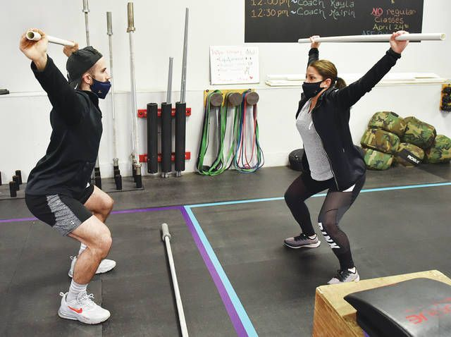 <p>During the grand opening of The Anthracite Fitness Factory, instructor Tyler Lutecki shows his mother Renee Lutecki the types of exercises he'll be instructing.</p>                                  <p>Tony Callaio | For Sunday Dispatch</p>