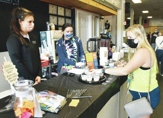 <p>Michelle Witek, right, samples some of the health food available from Lucca Fresca inside The Anthracite Fitness Factory. Looking on is Mattia Krappa, Lucca Fresca owner, left, and Cassandra Nocera, center.</p>                                  <p>Tony Callaio | For Sunday Dispatch</p>