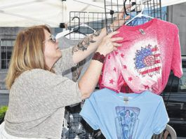 Debbie Watson, of Moon Grave Studio, preps the booth for Pittston City's first 2nd Friday Art Walk of the 2021 on May 14.                                  Tony Callaio | For Sunday Dispatch