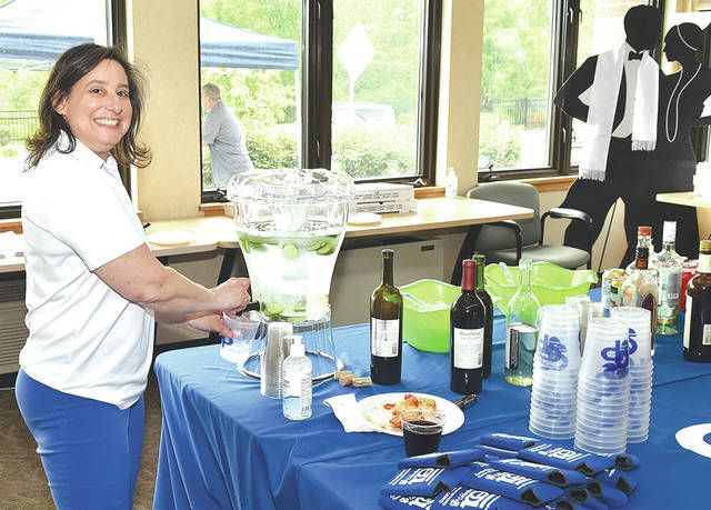 <p>Michelle Mikitish, Greater Pittston Chamber of Commerce executive vice president, does last minute preparations before taking part in the chamber's outing for National Pizza Day held for chamber members.</p>                                  <p>Tony Callaio | For Sunday Dispatch</p>