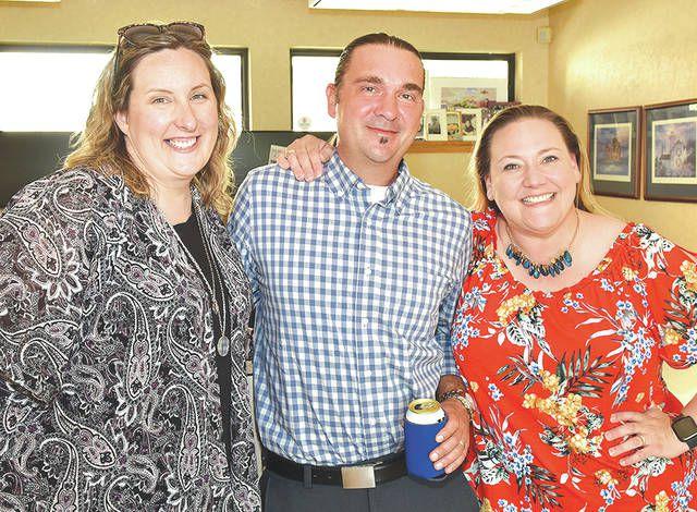 <p>Melissa and Julio Caprari, left/center, pose with the chamber's Brandi Bartush, right.</p>                                  <p>Tony Callaio | For Sunday Dispatch</p>