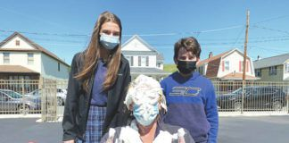 """Eighth grade teacher Mrs. Debbie Brady is covered in the pies thrown by Brooke Kroptavich and Chase Sciandra. The """"Pie In The Face Contest"""" raised over $500 for St. Jude's Hospital.                                  Submitted photo"""