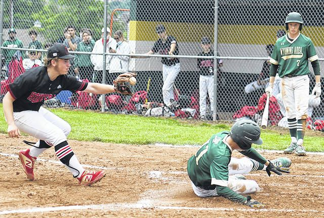 <p>Sam Supey (11) is safe stealing home for the scoring Wyoming Area's 5th run Honesdale Thursday afternoon.</p>                                  <p>Tony Callaio | For Times Leader</p>
