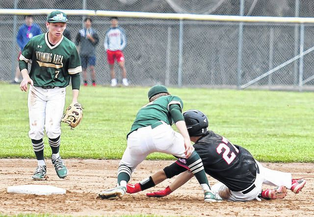 Wyoming Area Warrior shortstop Jason Wiedl (13) puts the tag on Honesdale's Timmy Jackson (27) attempting to steal second base.                                  Tony Callaio | For Times Leader