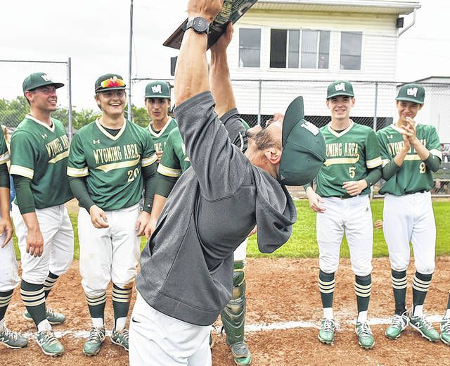 <p>Wyoming Area baseball coach Rob Lemoncelli hoists the District II AAAA winner's plaque. Lemoncelli is in his fourth year as head coach.</p>                                  <p>Tony Callaio | For Times Leader</p>