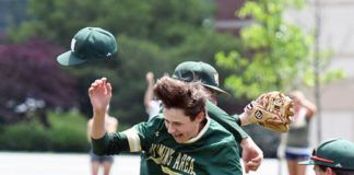 Wyoming Area pitcher Hunter Lawall (behind) and Nathan Novakowski (9) celebrate after defeating ELCO 6-4 Thursday in a PIAA Class 4A quarterfinal game at DeSales University.                                  Tony Callaio | For Times Leader
