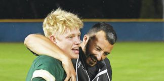 Warriors coach Rob Lemoncelli embraces Evan Melberger at the conclusion of Wyoming Area's seventh-inning rally in Monday's state semifinals.                                  Tony Callaio | For Times Leader