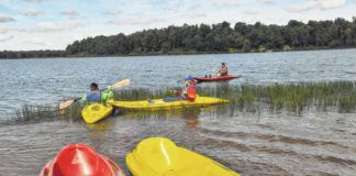 Kayakers are seen at Lake Jean in this file photo. The water at the Lake Jean swimming beach has been temporarily closed due to high bacteria levels, Ricketts Glen State Park officials announced Wednesday.                                  Times Leader file photo