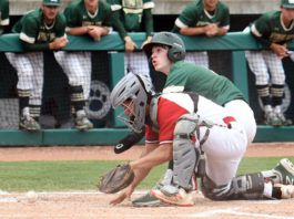 Wyoming Area's Matt Little looks up at the home plate umpire for the safe call as the ball gets away from New Castle catcher Nick Rodgers in the third inning of Friday's PIAA Class 4A championship in State College.                                  Tony Callaio | For Times Leader