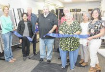 Done Rite Carpets & Flooring held a ribbon cutting ceremony on Friday, June 11 at the store's new showroom at 76 Main Street, Pittston. Shown in the photo, front row, left to right: Mary Kroptavich, Pittston City's Main Street manager, Barbara Quinn, building proprietor, Anthony Marranca, Done Rite sales manager, Mary Marranca, Michelle Mikitish, Greater Pittston Chamber of Commerce executive vice president. Back row: Marty Quinn, Jack Wise, Joyce Wise.                                  Photo courtesy Bob Price