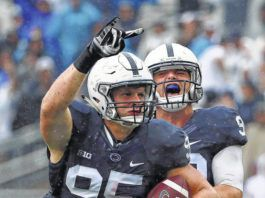 Penn State defensive end Carl Nassib (95) celebrates his second half interception with defensive end Garrett Sickels (90) during an NCAA college football game against Buffalo in State College, Pa., Saturday, Sept. 12, 2015.                                  AP file photo