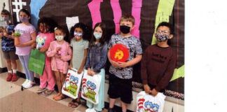 Shown are students from Wyoming Area Primary Center with some of the materials that were in their Take Home Bags. From left are Jackson Berger, Skye Gilroy, Michaela Johnson, Nova Pocceschi, Tatiana Speece, Camryn Smith, Gavin Petrikonis and Rafael Garcia-Contreras.                                  Submitted photo