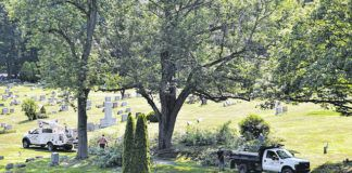 Pittston officals and staff particpated in Mayor Michael Lombardo's first Monthy Matters program by cleaning up, making repairs, trimming trees of the Pittston Cemetery.                                  Tony Callaio   For Sunday Dispatch