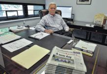 Mike Murray is seen at his desk at the Times Leader Media Group's East Market Street offices in this file photo. Murray announced his retirement as Times Leader Media Group Publisher on Friday afternoon.                                  Times Leader file photo