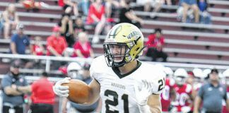 Wyoming Area Warrior junior Drew Mruk sees daylight and the goal line scoring a touchdown at Hazleton Area in Week 1 of the high school football season. The Warriors went on the win 35-7.                                  Tony Callaio file photo   For Times Leader