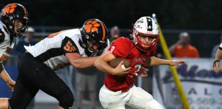 Tunkhannock defense end Nick Marabell sacks the Patriots' Drew DeLucca for a loss.                                  Tony Callaio   For Times Leader                                 Tony Callaio   For Times Leader