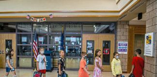 A class of students walks through the hallway during the first day of school at Mars Area Elementary School near Pittsburgh on Aug. 25. A statewide mask mandate for Pennsylvania schools went into effect Tuesday with some school districts in open defiance of the Wolf administration, while GOP leaders in the state House planned to come back to Harrisburg early to mount a legislative response.                                  Alexandra Wimley | Pittsburgh Post-Gazette via AP
