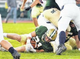 Nanticoke Area fumbled on the first play from scrimmage. The ball was recovered by Wyoming Area's Drew Mruk (21).                                  Tony Callaio   For Sunday Dispatch