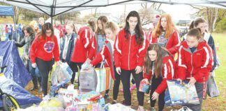 Pittston Area Girls Basketball team has donated to the Greater Pittston Santa Squad in previous years, as shown in the photo during the annual Santa Squad Turkey Bowl touch football game in 2019.                                  Tony Callaio file photo | For Sunday Dispatch