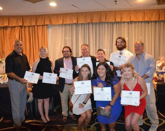 The winners of the night with their certificates are shown, from left: Al Brogna, Kim Naylor, JJ Mullin, John Morgan, Jen Roberts, Jacob Richards, Dr. Jim McDermott, Kara Moscatelli, Rosie Fasciana and Micayla Grey.