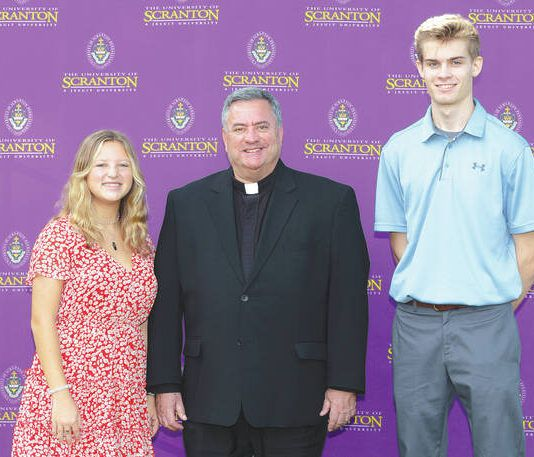 From left are Grace Washney, the Rev. Joseph Marina, S.J., president of The University of Scranton, and Patrick DelBalso.                                  Submitted photo